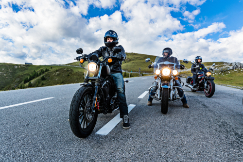 Motorcycle drivers riding in Alpine highway