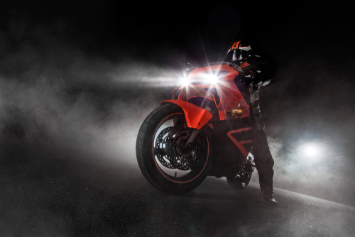 Supersport motorcycle driver at night