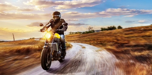 motorcycle riding on dirt road