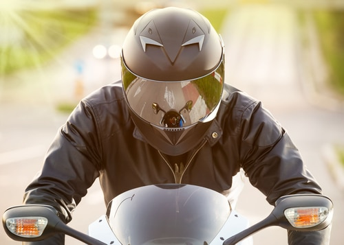 motorcyclist in black riding his super sport motorcycle