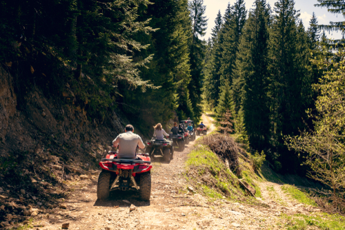 tour group travels on ATVs