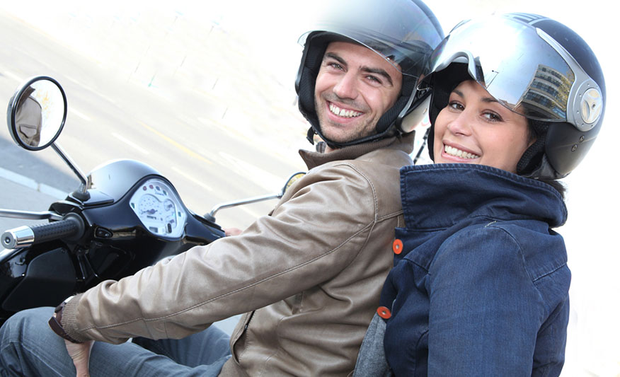 smiling couple on motorcycle
