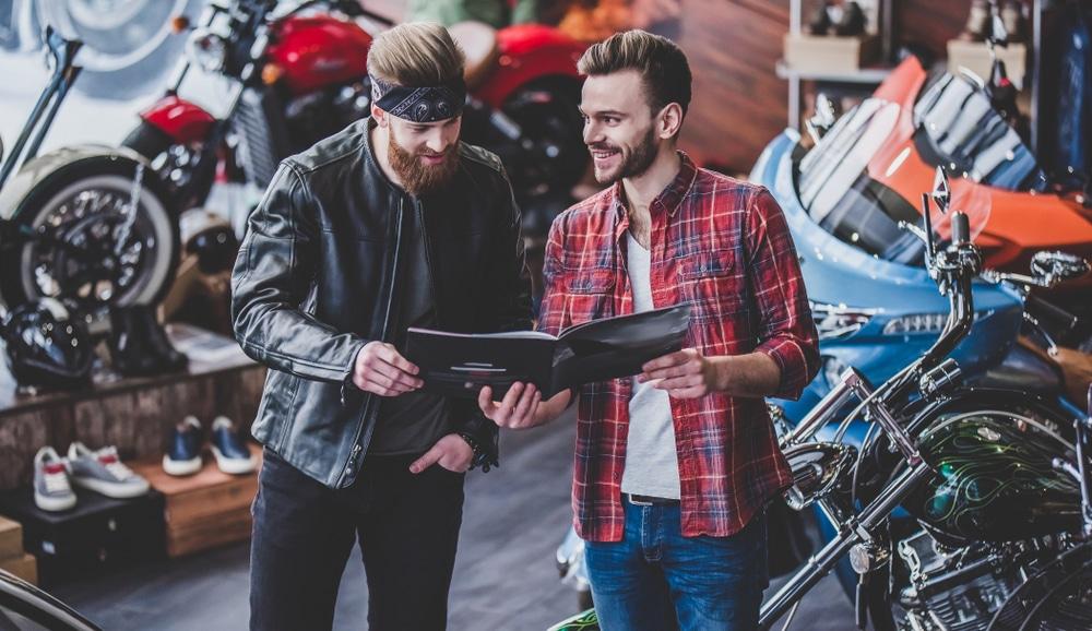 Two men in motorcycle shop