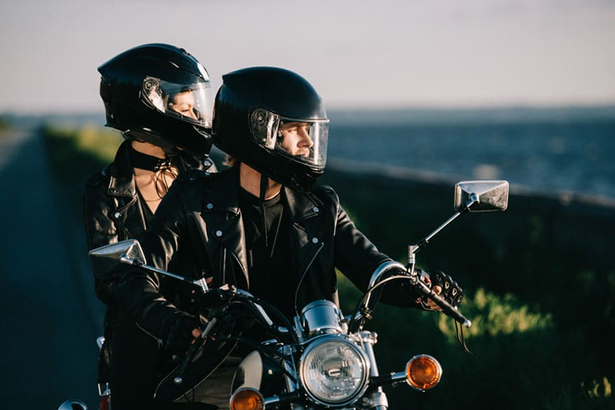 couple bikers riding motorcycle