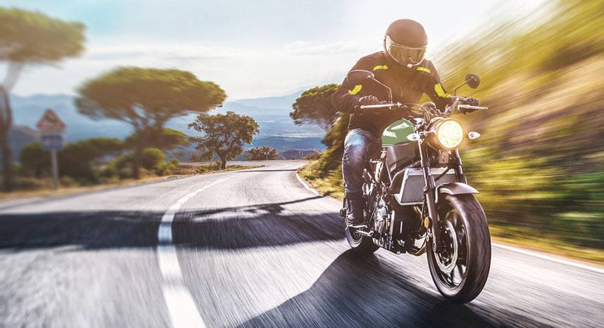 motorcyclist on road riding