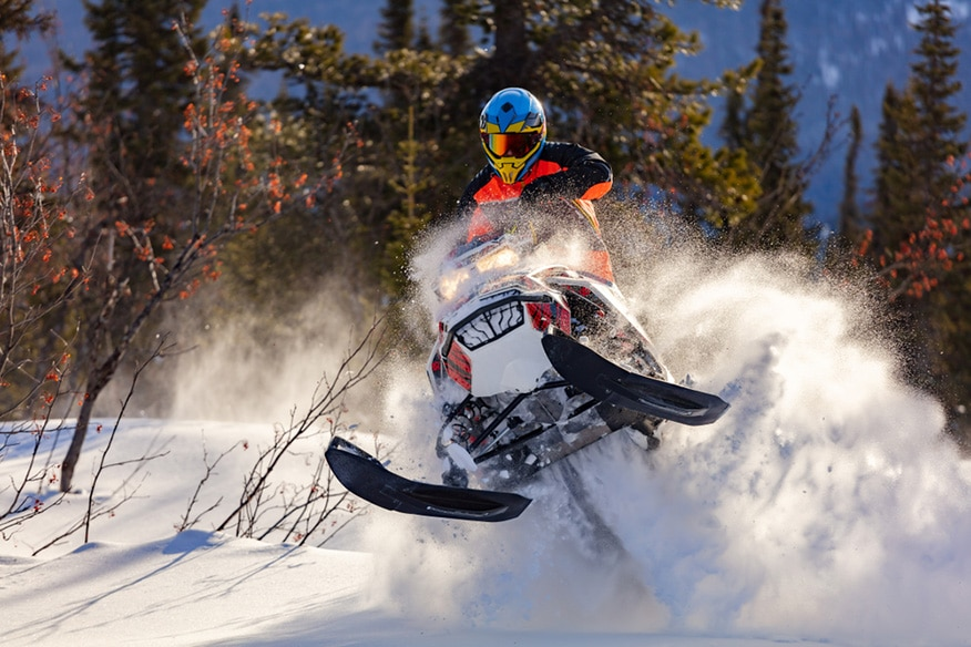 jumping on a snowmobile
