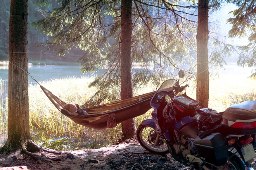 Camping in forest on side mountain lake
