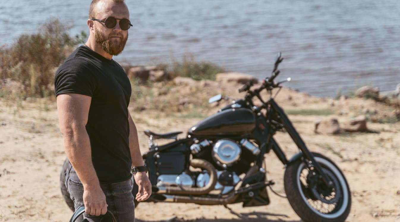 Man posing with motorcycle