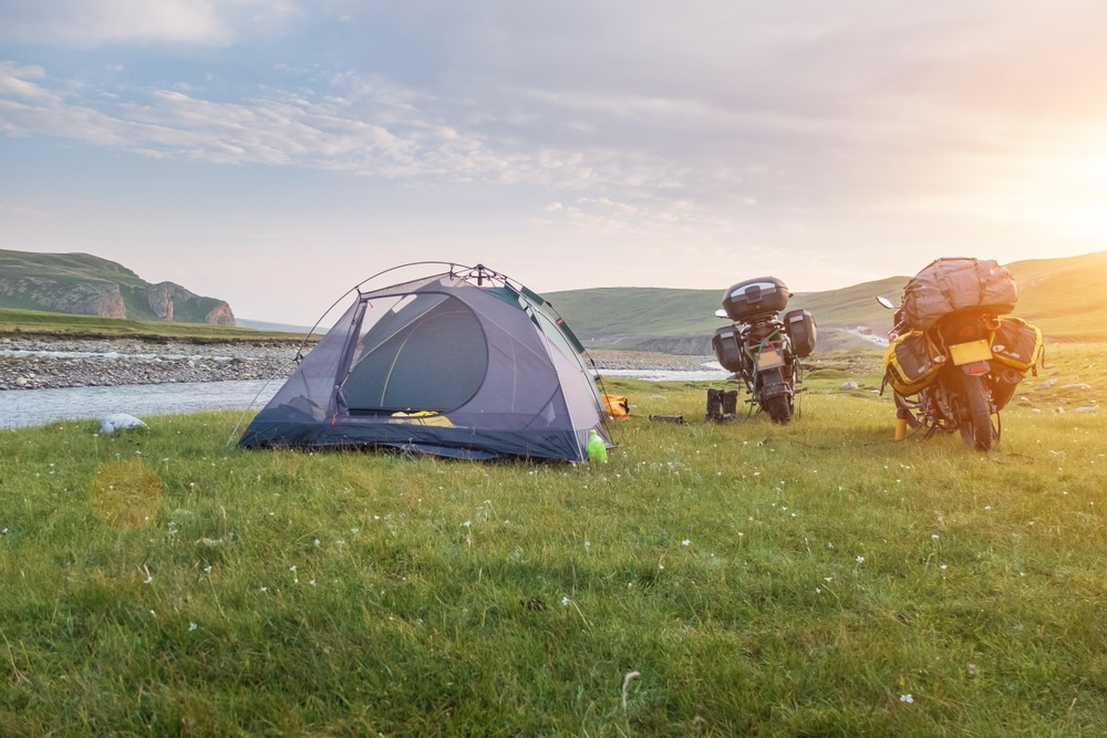 Two tents with off road adventure traveling motorcycle camping