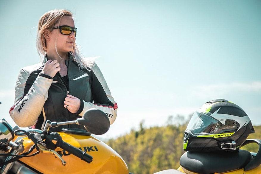 Woman biker with cardo communication headset