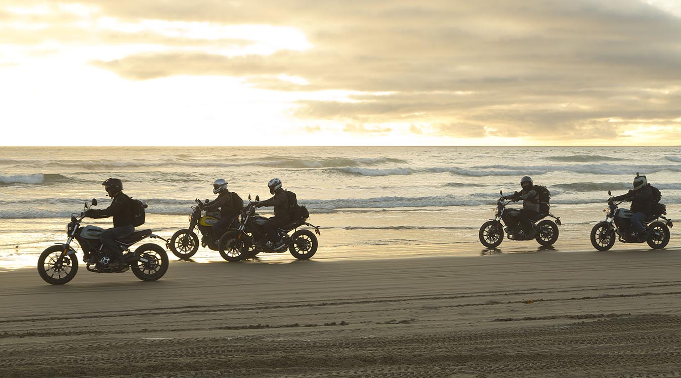 bikers riding on beach