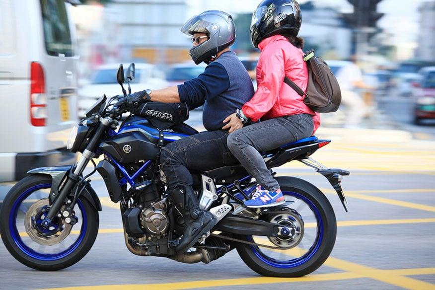 couple riding on yamaha motorcycle