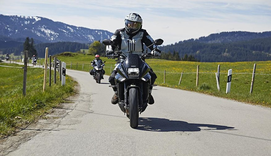 front view of motorcyclist on road