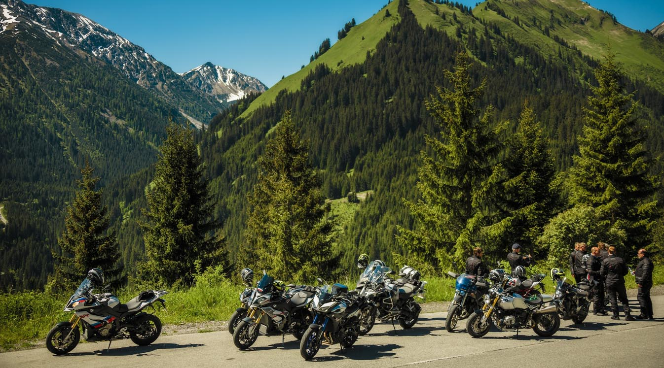 group of bikers parked on rugged roadside