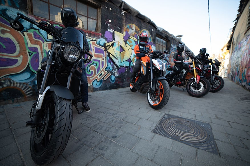 row of bikes in alley