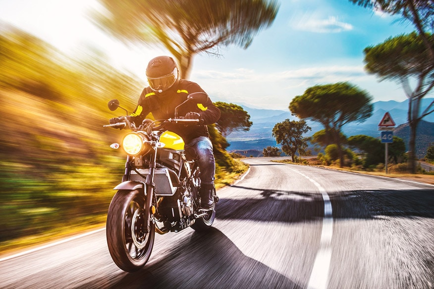 driving the empty road on a motorcycle