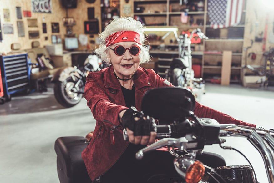 stylish woman riding motorcycle