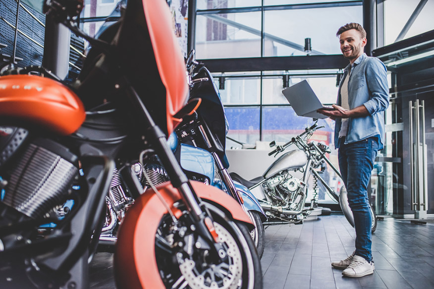 Motorcycle Salesman with laptop