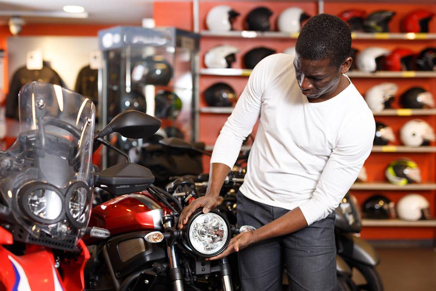 man choosing new bike in motorcycle store