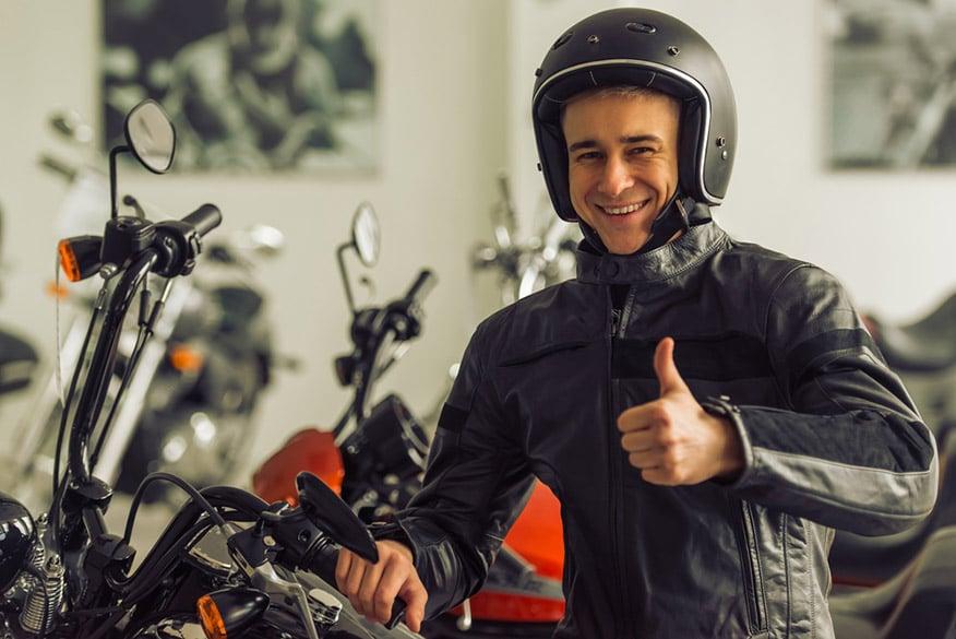 man in black leather jacket and helmet