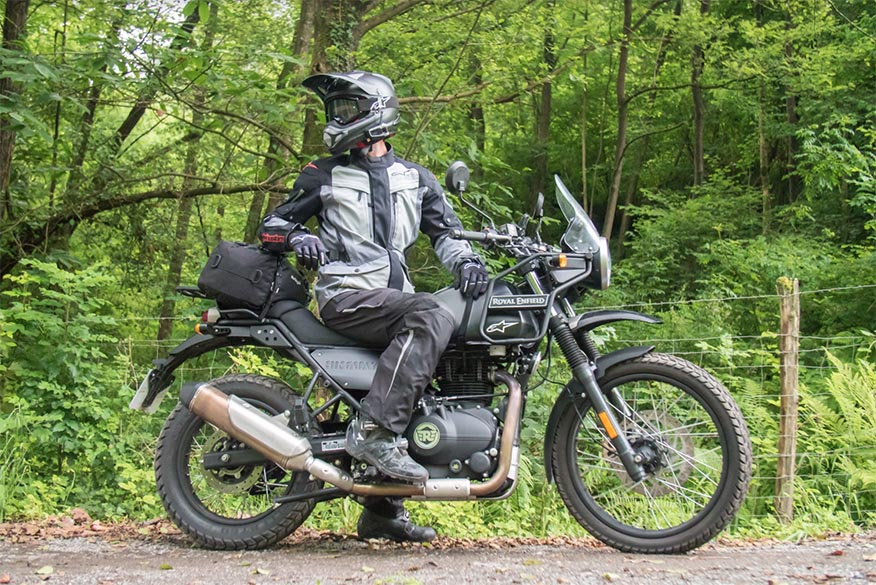 biker leaning on bags