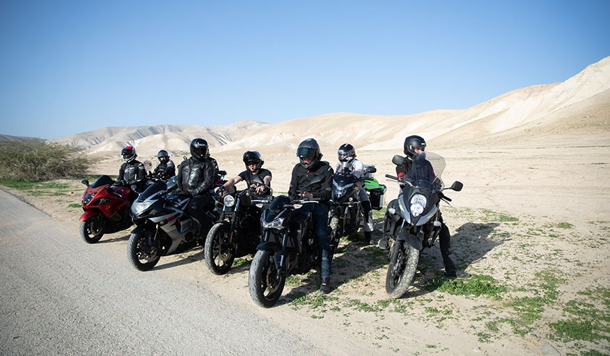 bikers-parked-side-desert-road
