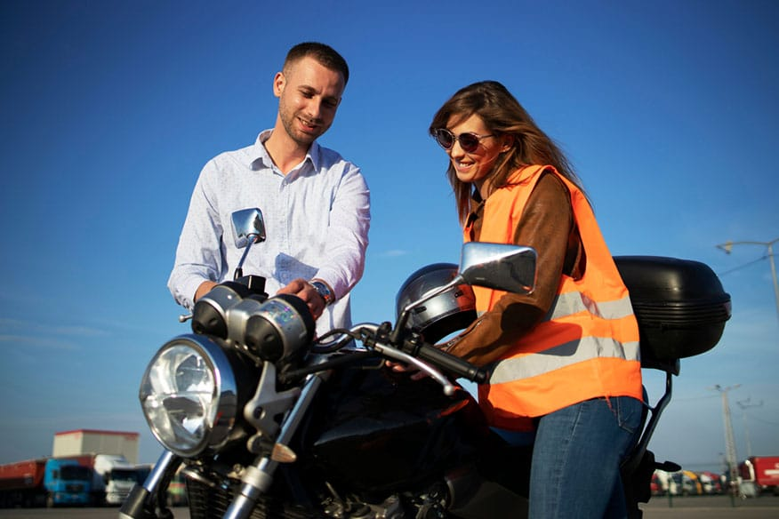 instructor with motorcyclist