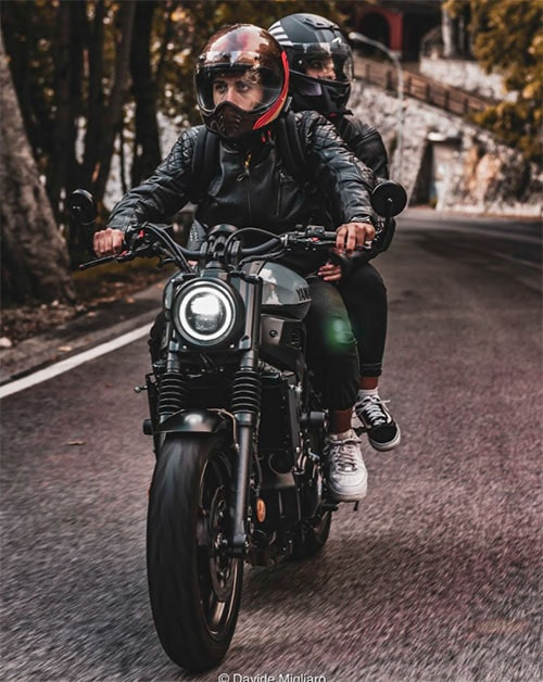 pair riding on motorcycle