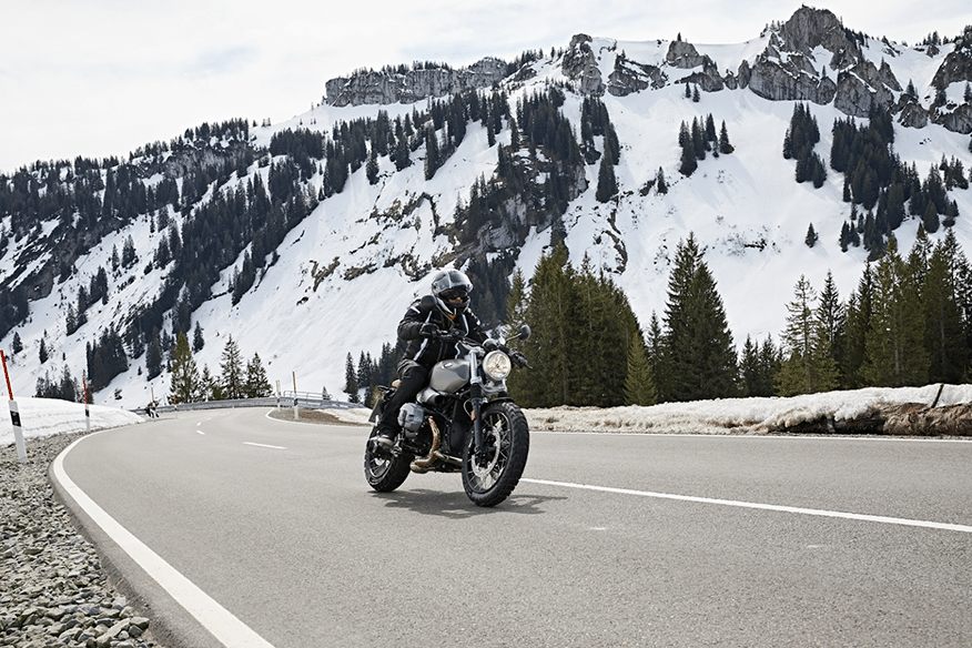 driving by mountains on motorcycle