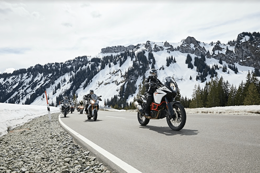 friends ride on mountain highway