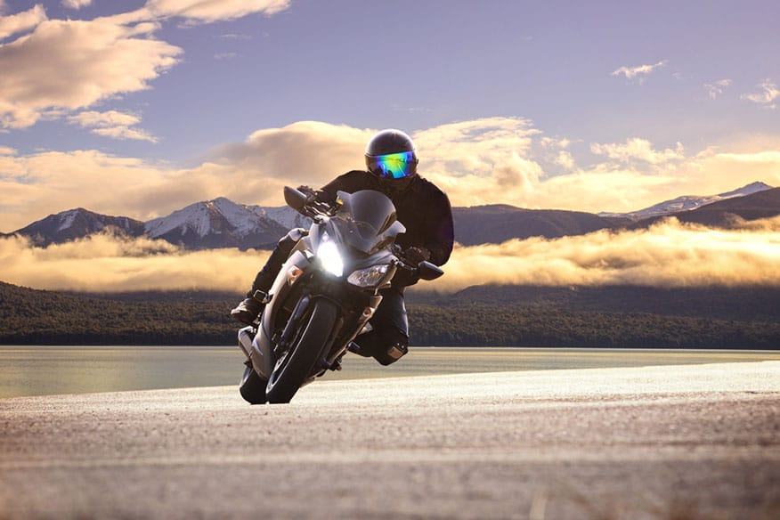 young bike man riding motorcycle in traveling trip