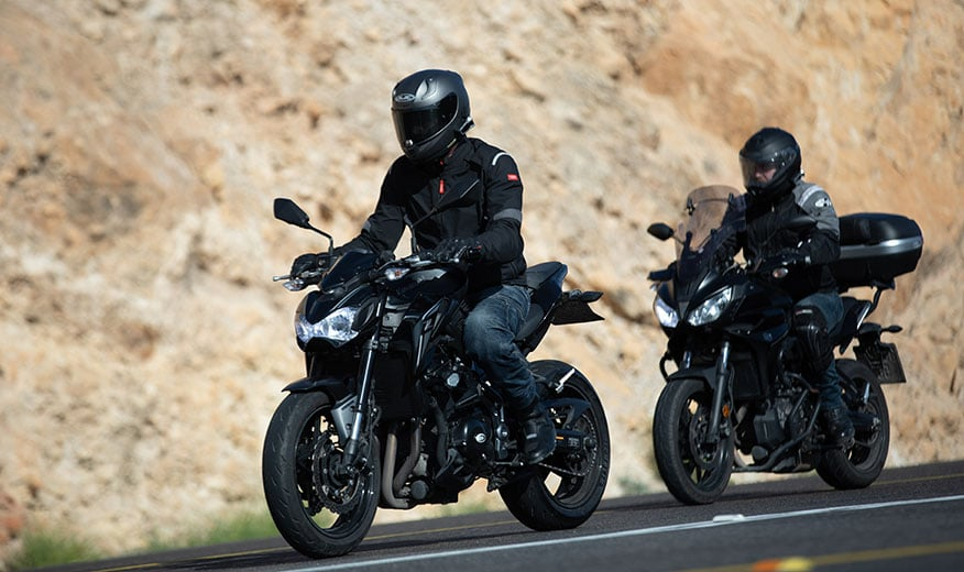 pair bikers riding on road