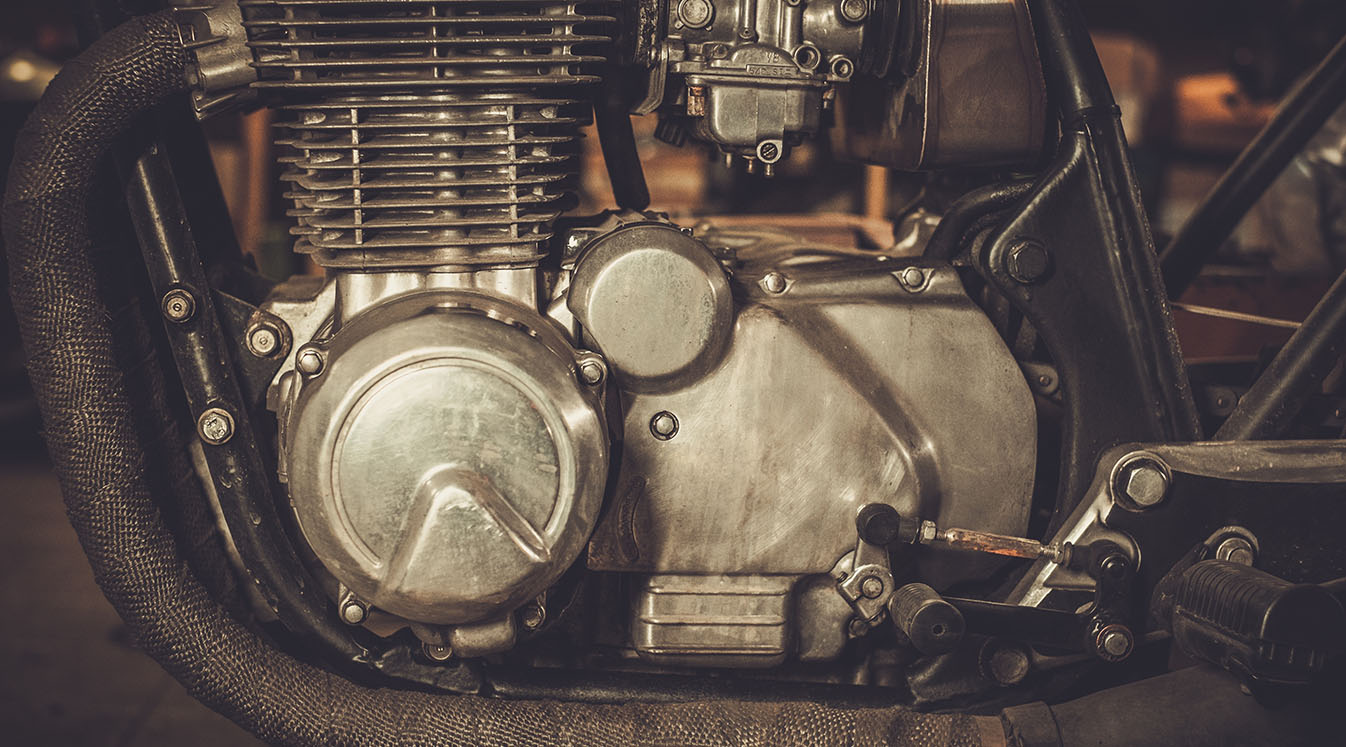 a close up of a cafe racer motorcycle engine