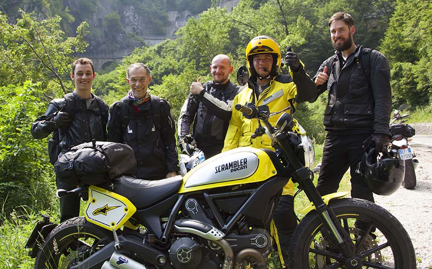 a group of bikers giving a thumbs up