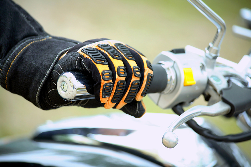 a bikers hand resting on the handlebars