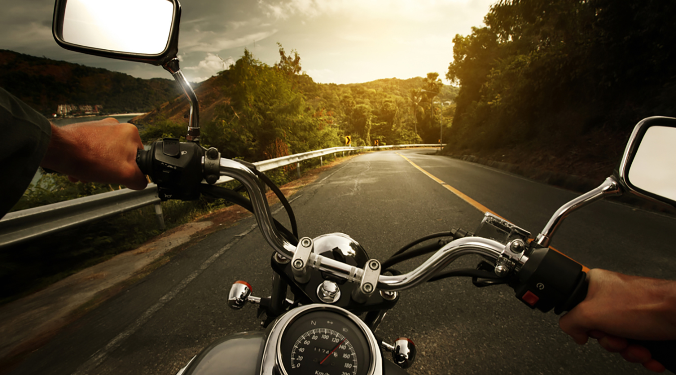 a point of view shot of a someone riding a motorcycle down a road
