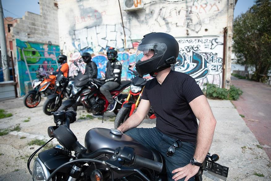 bikers wearing helmets in alley