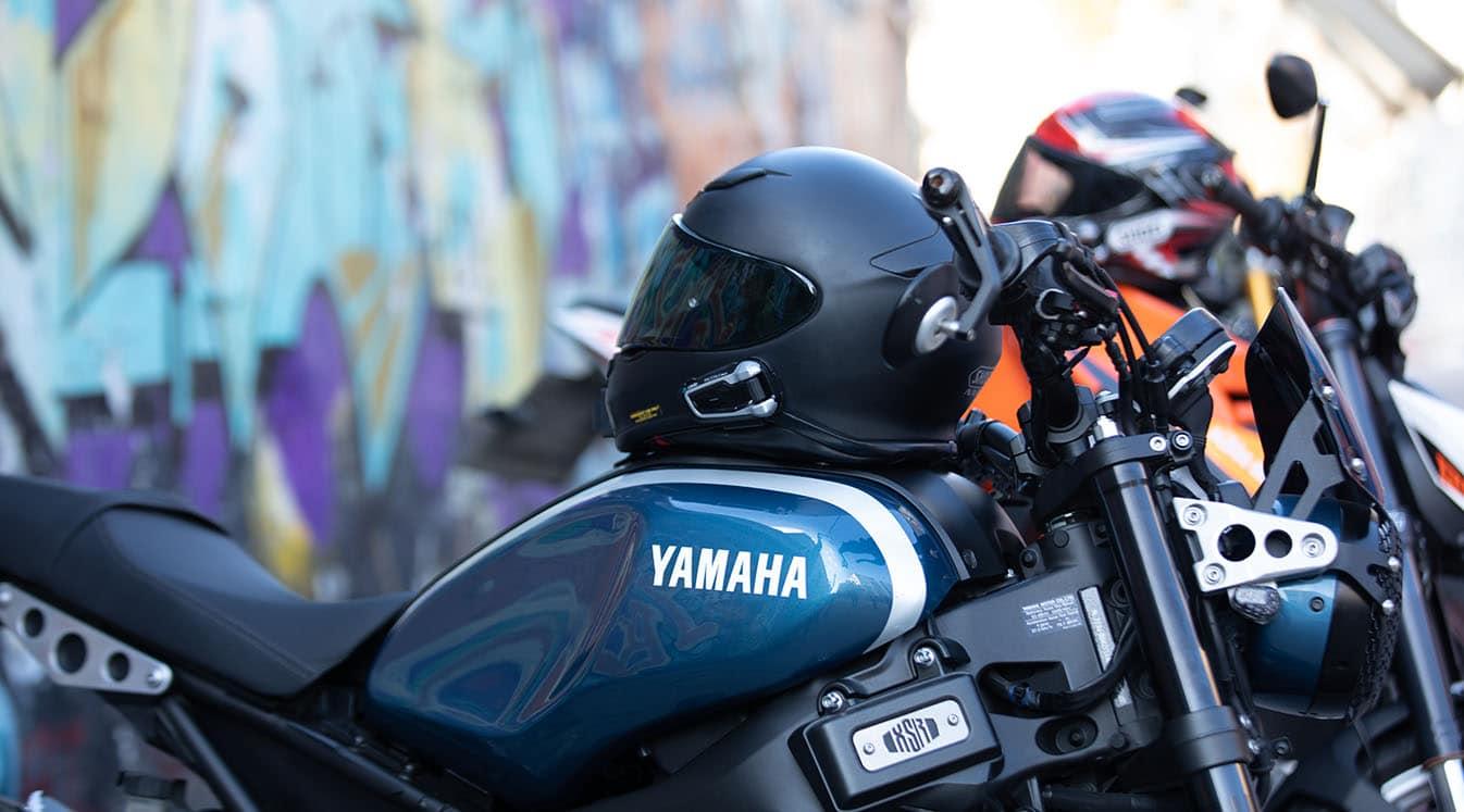 row of helmets on bikes