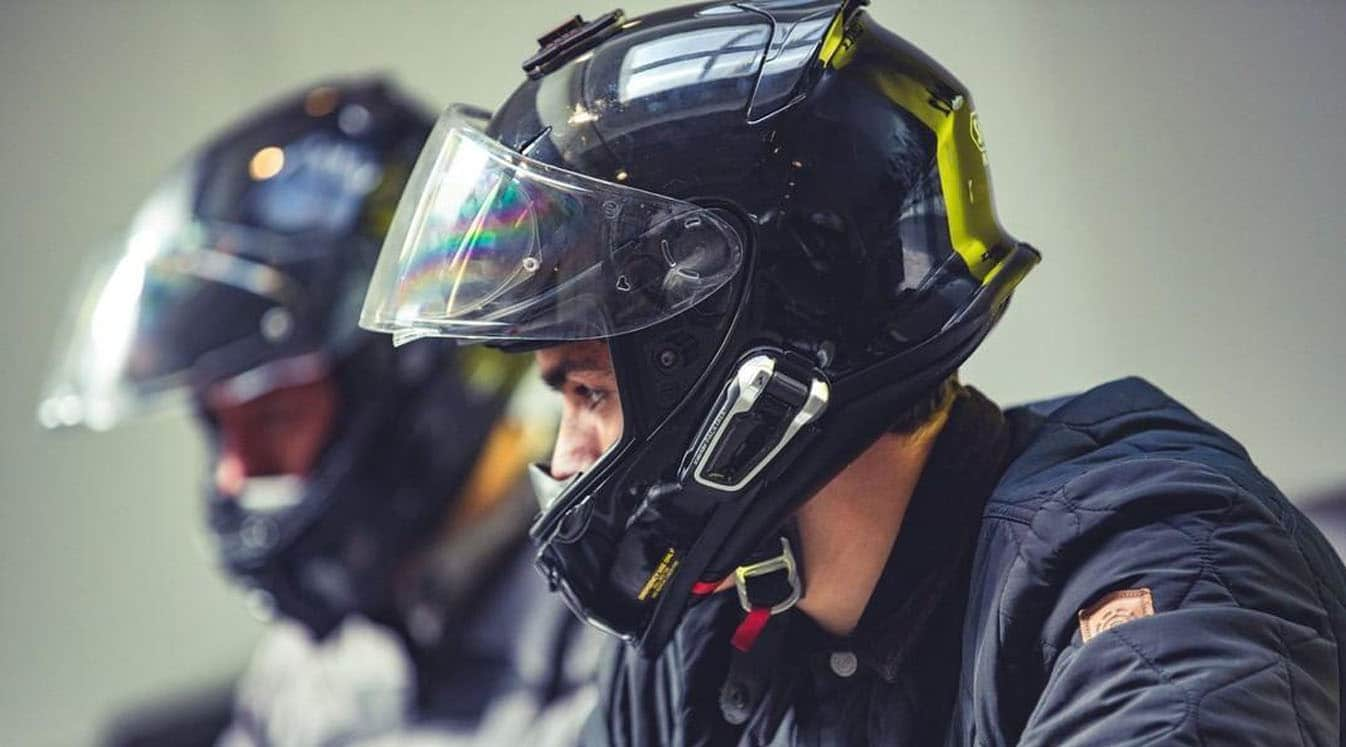 two bikers with their helmets on
