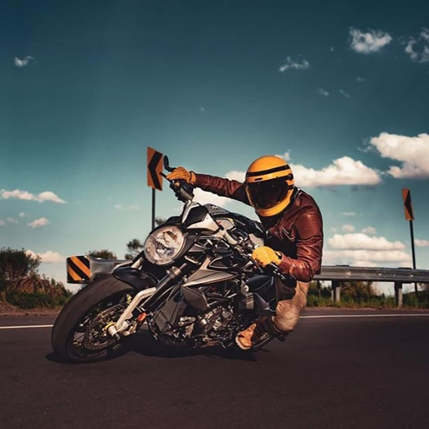 a biker leaning hard into a turn