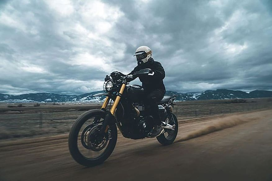 a biker riding in overcast weather