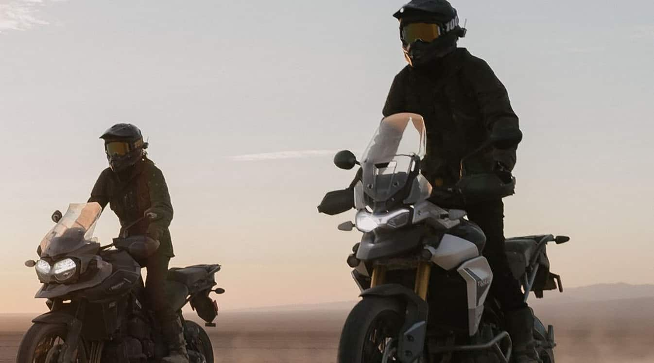 two bikers sitting on their bikes