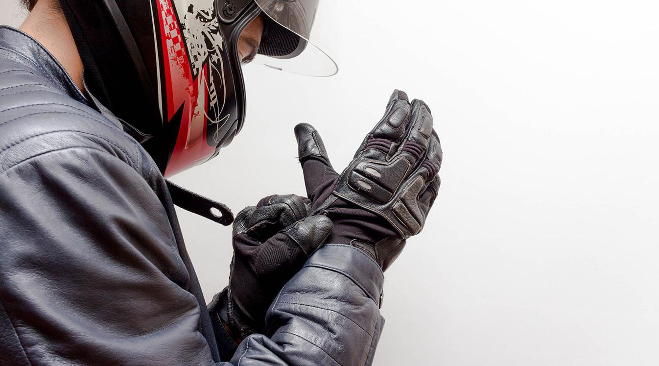 Motorcycle Guy Wearing Helmet and Leather Jacket