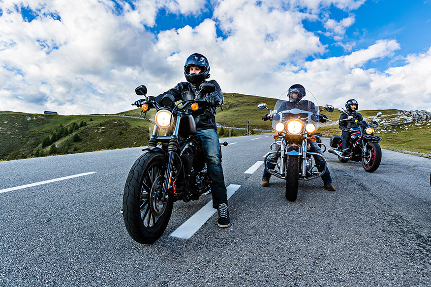 Motorcycle drivers riding in Alpine highway,