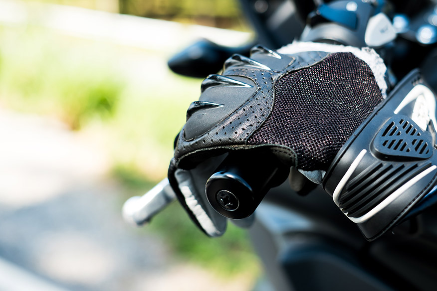 motorcycle glove is placing on the motorcycle handle